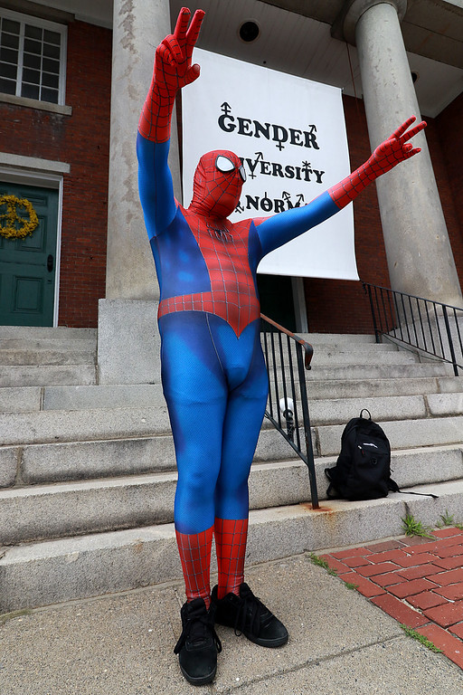 ". Tony McGregor a member of ""Wil and the Tribe\"" was dressed as Spider-Man on Thursday afternoon in front of the First Parish Church in Fitchburg. He was waving to cars as they passed by in an attempt to put a smile on everyone\'s face on the first day of summer. SENTINEL & ENTERPRISE/JOHN LOVE"