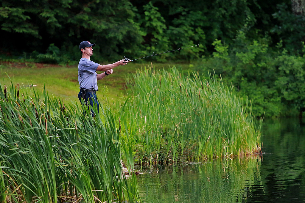 . The rain did not stop Dario Barreiro of Fitchburg from taking some time late in the day to do some fishing at Round Meadow Pond in Westminster. SENTINEL & ENTERPRISE/JOHN LOVE