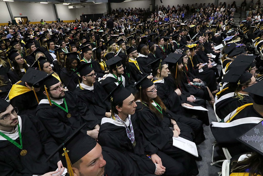 . The 122nd annual Fitchburg State University Commencement was held on Saturday, May 19, 2018 in the university\'s Recreation Center. Graduates listen to speakers at the ceremony. SENTINEL & ENTERPRISE/JOHN LOVE