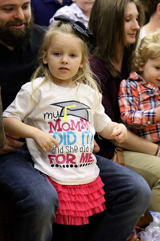 . Mount Wachusett Community College held its fifty-third commencement on Wednesday, May 16, 2018. Penelope Johnson, 4, from Erving MA was wearing a shirt in support of her mom Justine Pottinger who was one of the graduates at the ceremony. SENTINEL & ENTERPRISE/JOHN LOVE