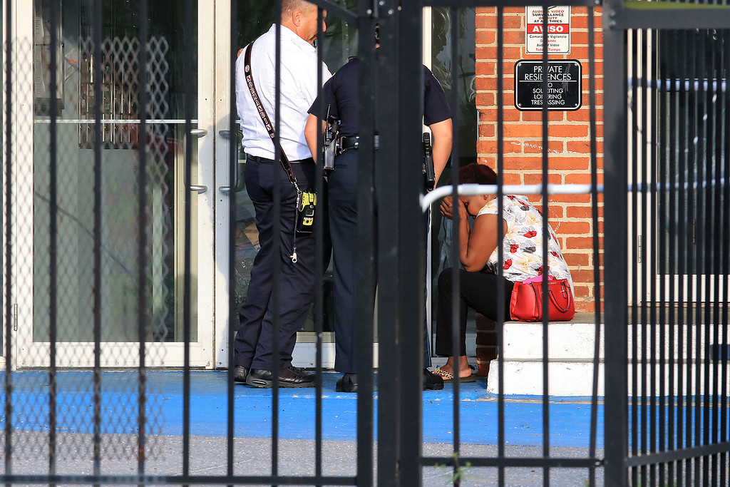 . Fitchburg Police chat with a woman at the scene where a 2 year old child fell from a window of an apartment building at 11 Willow Street according to police radio broadcasts. SENTINEL & ENTERPRISE/JOHN LOVE