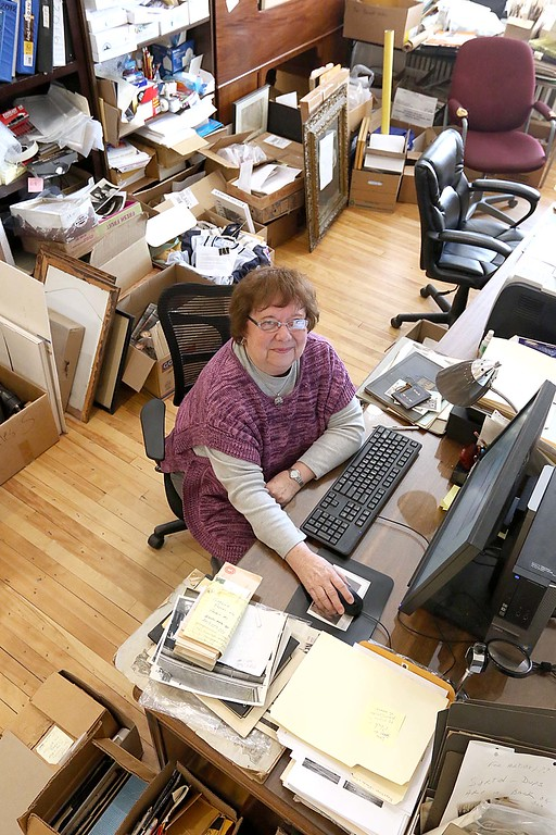 . Volunteer at the Fitchburg Historical Society Simone Blake talks about what she does for them at her desk at their offices on main Street Friday morning, April 6, 2018. SENTINEL & ENTERPRISE/JOHN LOVE