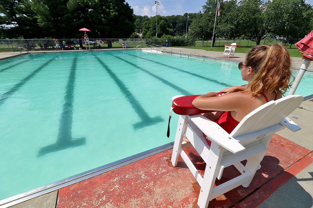 . The pool at the J. Robert Crowley Swimming Complex at Coolidge Park in Fitchburg is open again. Life Guard Emily Celona watches over the pool on Friday, July 27, 2018. She has been a life guard at the pool for two years. SENTINEL & ENTERPRISE/JOHN LOVE