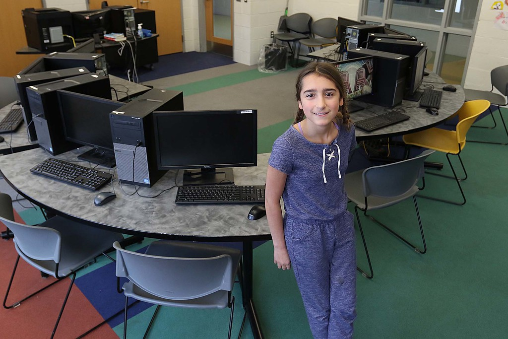 . Abby Muller, 11, talks about making websites and coding at a new program at the Boys & Girls Club of Fitchburg and Leominster on Friday at the club. SENTINEL & ENTERPRISE/JOHN LOVE