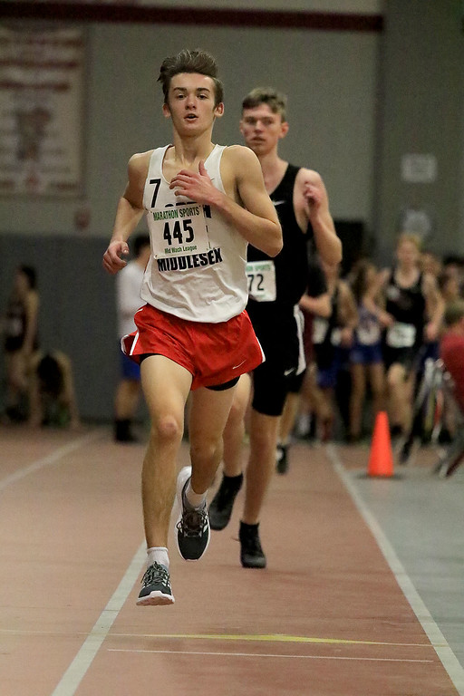 . North Middlesex Regional High School\'s Everett Smith competes in the 2 mile at the Mid Wach League Dual Meet at Fitchburg High School on Saturday, December 8, 2018. SENTINEL and ENTERPRISE/JOHN LOVE