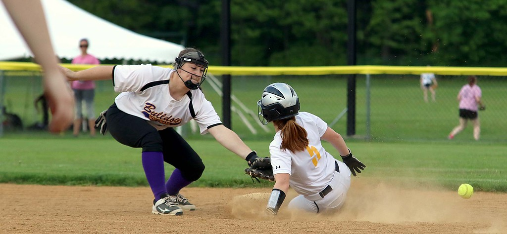 . Montachusett Regional Vocational Technical School softball played St Bernard\'s High School on Wednesday afternoon. the slipped by Monty Tech player Mallory LeBlanc as she tried to get out stealing St. B\'s player Lissa Hoyt During action in the game. SENTINEL & ENTERPRISE/JOHN LOVE