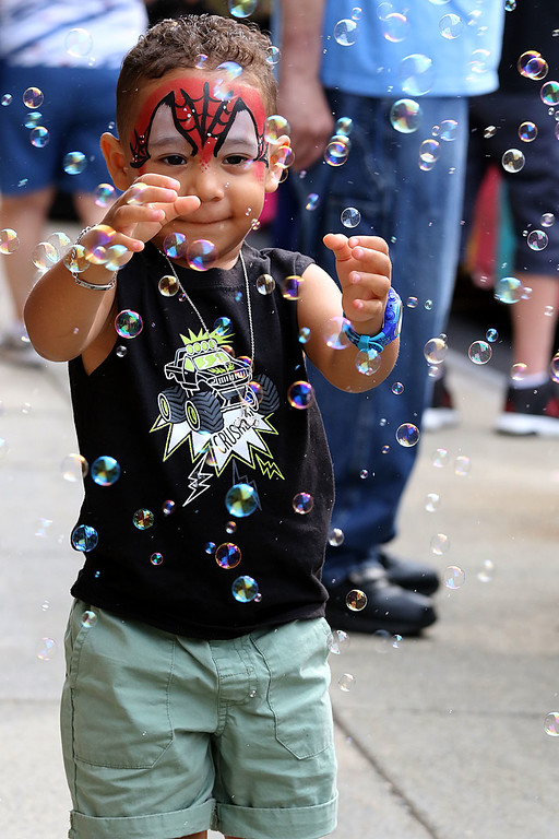 . Leominster annual kids day was held on Saturday at Monument Square. Estevan Rodriguez, 2, plays among the bubbles outside of Central Flag and Gifts during the event. SENTINEL & ENTERPRISE/JOHN LOVE