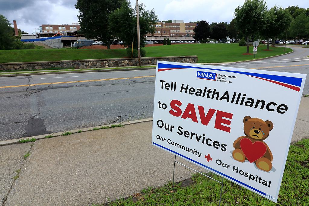 . This sign across the street from HealthAlliance in Leominster is asking the for help to save the hospital from proposed cuts. SENTINEL & ENTERPRISE/JOHN LOVE
