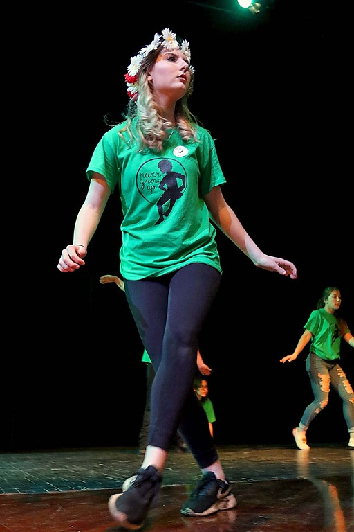 . Oakmont Regional High School student Eden Koljian  playing Tiger Lily rehearses for the play Peter Pan at the school on Friday afternoon. SENTINEL & ENTERPRISE/JOHN LOVE