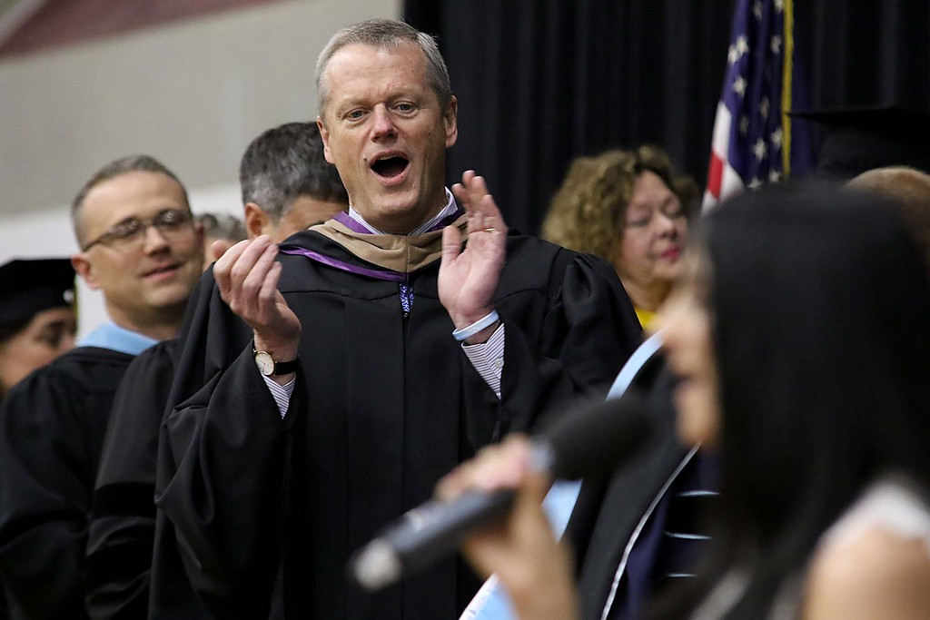 . Mount Wachusett Community College held its fifty-third commencement on Wednesday, May 16, 2018. Gov. Charlie Baker cheers for Whitney Doucet at end of her performance of the national anthem to start the ceremony.  SENTINEL & ENTERPRISE/JOHN LOVE