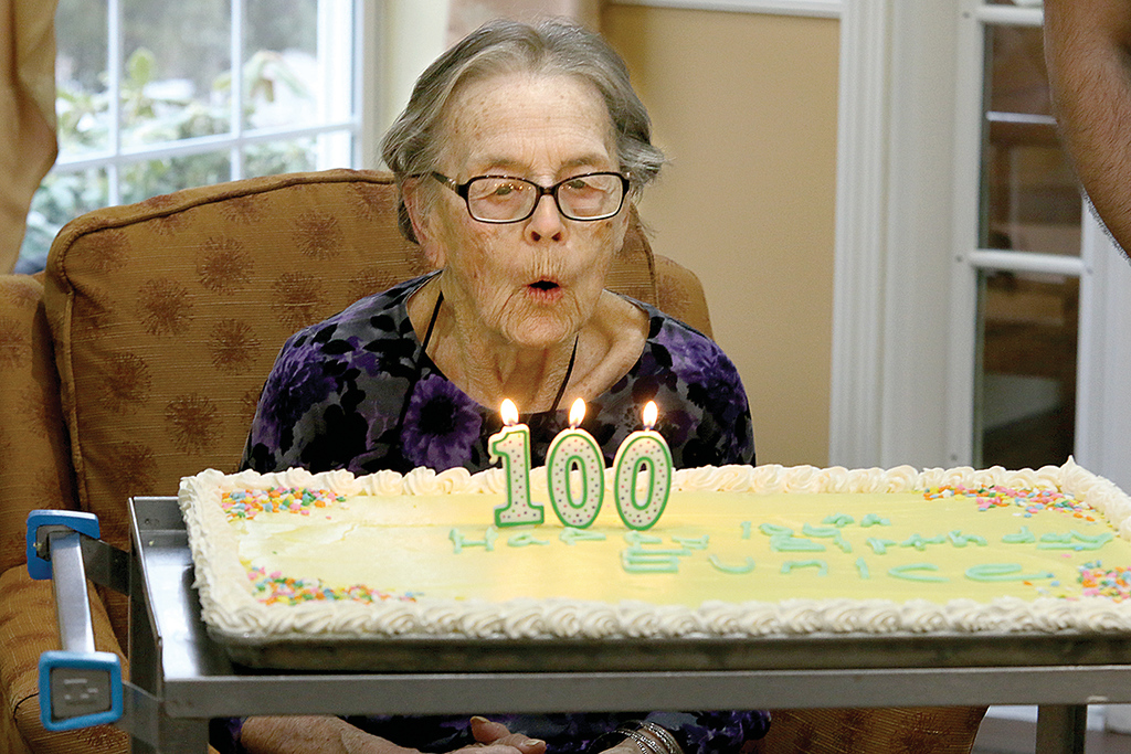 . Eunice Wiles blows out her candles at her 100th birthday party held at the Manor On the Hill Tuesday, January 23, 2018. SENTINEL & ENTERPRISE/JOHN LOVE