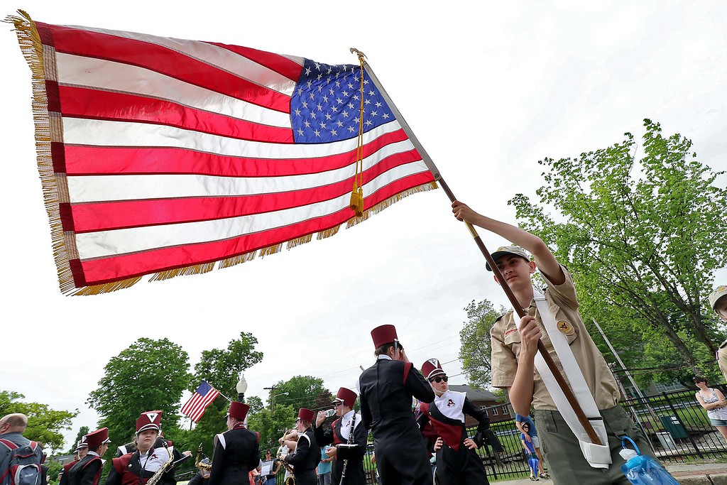 . The Town of Ayer held its Memorial Day parade and ceremony on Saturday May 26, 2018. The Parade went down Park Street to Main Street and stop for a ceremony at Town Hall. After that they went on to the Pirone Park where a wreath was thrown into Grove Pond. Boy Scout Dawson Testa from Troop 3 holds the American flag during the ceremony at town hall. SENTINEL & ENTERPRISE/JOHN LOVE