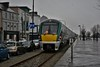 22019 proceeds at 5 mph along Wexford Quay with the 0940 Rosslare Europort - Connolly. The low speed limit is due to the railway intersecting with pedestrians and other road users on the quay section. Mon 02.04.18