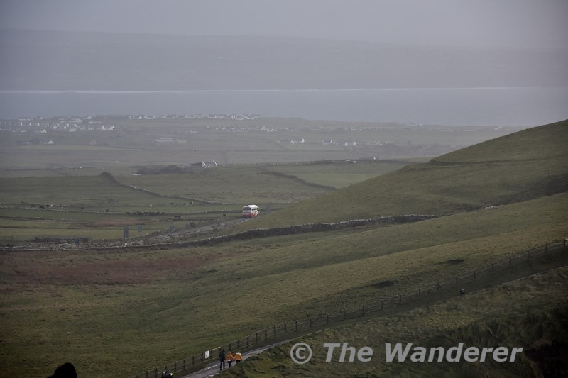 Looking inland at the Cliffs of Moher near Liscannor, Co. Clare. The 1600 Galway - Ennis 350 route Bus Eireann service can be seen heading towards Liscannor. Sat 03.11.18