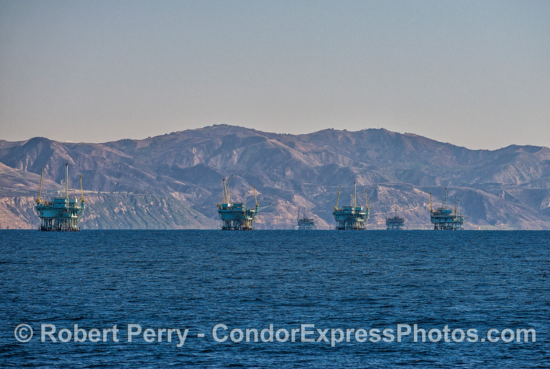 The Santa Barbara to Carpinteria line of 7 offshore oil platforms.  From left to right we see Platforms C, B, A, Hillhouse, then in the distance Platforms Henry, Houchin and Hogan.
