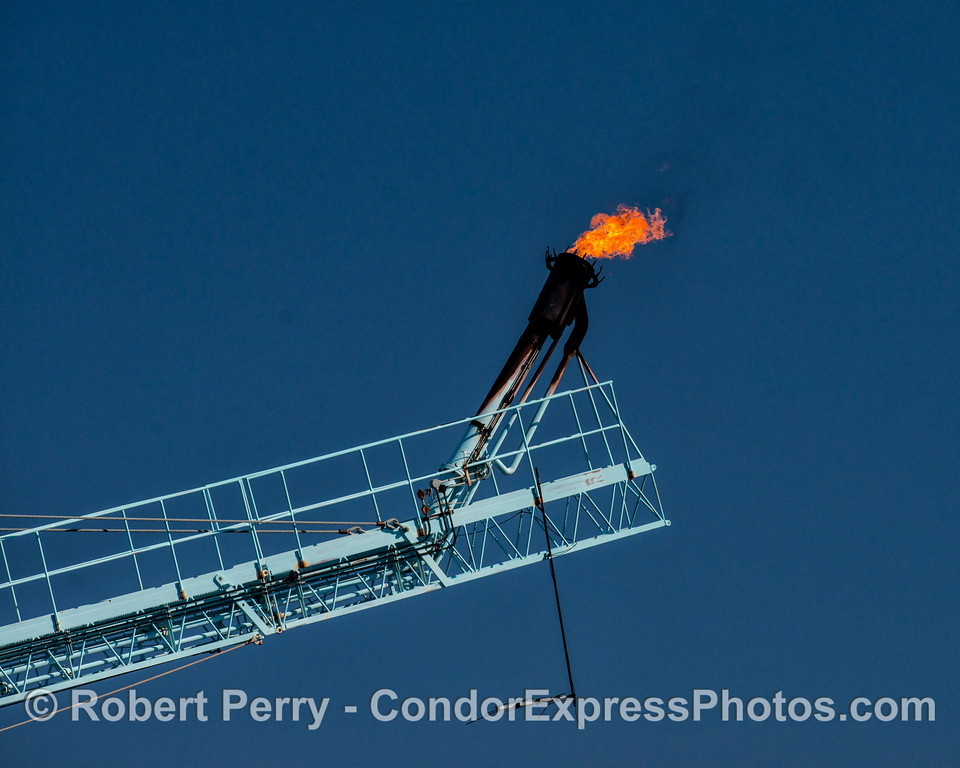 Oil platform gas burn-off flame.