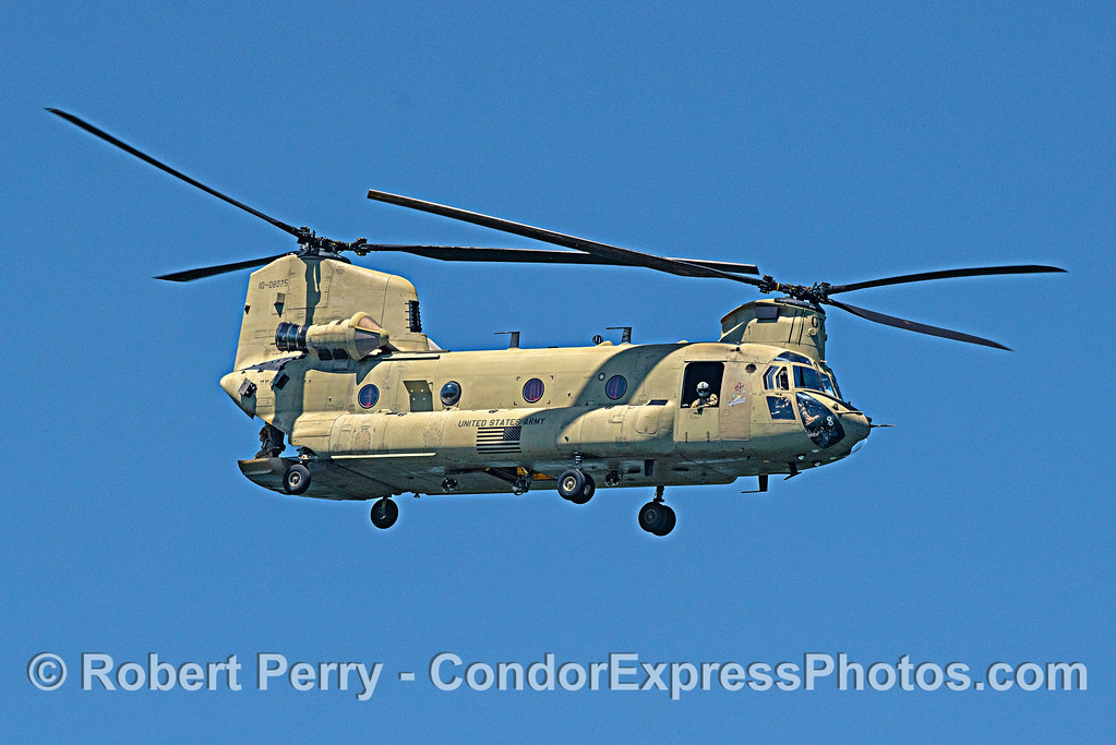 Chinook. Note soldiers on tailgate enjoying the moment
