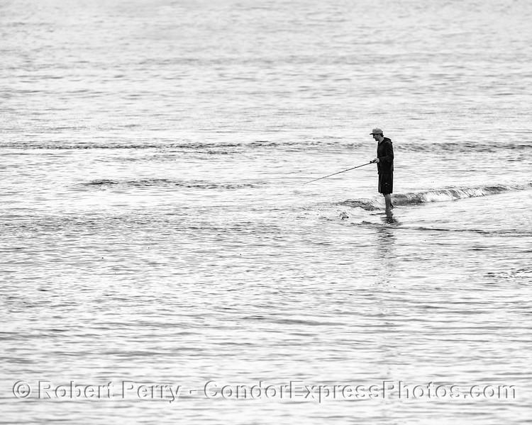 Lone fisherman.  (black and white)