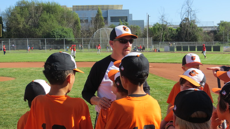 OUT TO THE BALL GAME; MIKE IS THE COACH OF ZACHARY'S TEAM