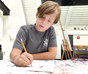 Atlin Mogus, 10, works on his Manga drawing during Two Rivers Gallery Creativity Camp 2-Dimensional Explorations'. Rebecca Dell , a local artist, was teaching children the art of drawing Manga. Citizen photo by Brent Braaten       July 26 2018