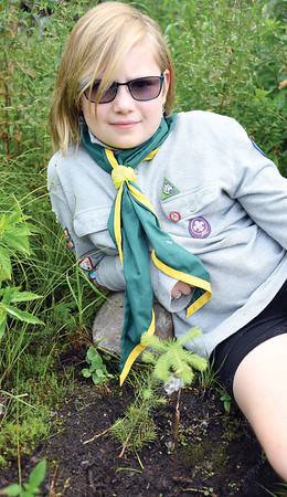 Robyn Bennett, 9, with the tree she planted with her Scout troop at Scouts Canada Echo Camp on the Caine Forest Service Road. After the terrible wildfires last year she wanted to do something to help so she got her Scout Troop to join Scouttrees a program that sees Scouts replant trees. Citizen photo by Brent Braaten    July 26 2018