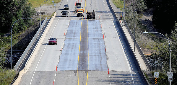 Crews from YRB used linseed oil to seal the concrete deck on the Foothills bridge Friday morning. July 27 2018