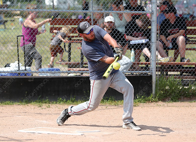 The Leftovers player Shawn Stewart makes solid contact with the ball on Sunday afternoon at Pineview Community Hall ball diamonds during a slo-pitch tournament as part of Pineview SunFrolics. Citizen Photo by James Doyle      July 29, 2018