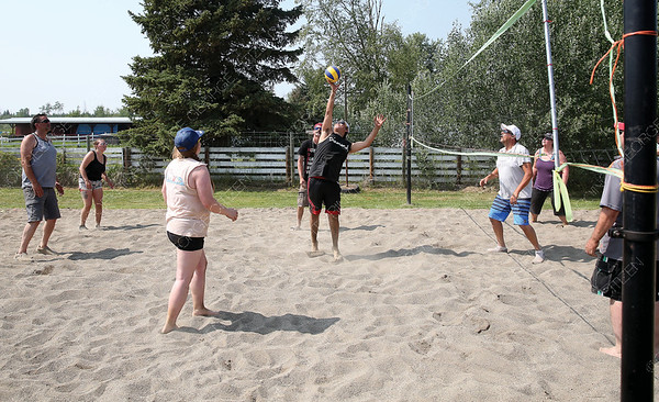 An A-Team player hits the ball over the net against Findom on Sunday afternoon at Malcolm McLeod Hall volleyball courts during a beach volleyball tournament as part of Pineview SunFrolics. Citizen Photo by James Doyle      July 29, 2018