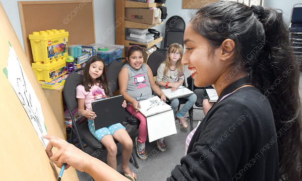 Sketch artist Harsh Preet demonstrates sketching techniques during Community Arts Council Skeetch Monkey at Studio 2880 Wednesday morning. Children in the half day class learned how to skeetch a monkey using the skills they were taught. Citizen photo by Brent Braaten     Aug 1 2018