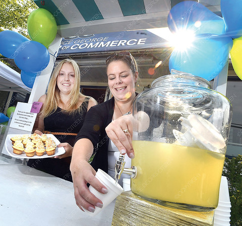 """Tianna Rossi, left, and Erin Tulle from the Chamber of Commerce with their lemonaid for sale Wednesday during the 6th annual Big Squeeze lemonaid sales competition. It was a fun day that allowed for some friendly competition between businesses (as teams) that registered to set up a lemonade stand to sell their """"secret recipe lemonade"""" by donation to the community. The teams were spread around Prince George all competeing for great lemon trophy. There were two awards, one for the best tasting lemonade as deemed by a panel of judges, and the second for the team who raised the most money. All proceeds from the Big Squeeze stay in Prince George to support Big Brothers Big Sisters proactive mentoring programs.  Citizen photo by Brent Braaten    Aug 1 2018"""