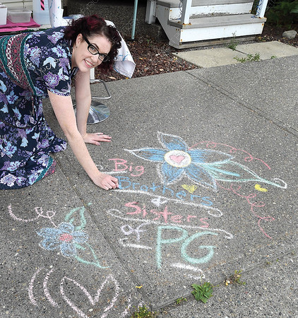 Mandy Paavola from MP Make Up Artistry does some side walk art to promote the Big Squeeze at the Chamber of Commerce lemonade stand Wednesday morning. The event was a fundraiser for Big Brothers Big Sisters mentoring programs. Aug 1 2018