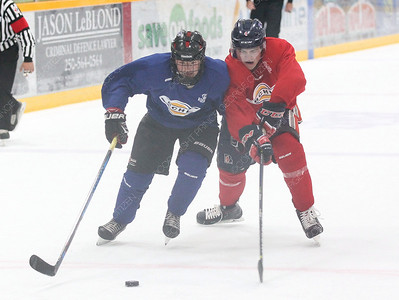 Team Blue player Alex Ochitwa and Team Red player Brayden Davis battle for the puck on Friday night at Rolling Mix Concrete Arena during Prince George Spruce Kings training camp. Citizen Photo by James Doyle       August 24, 2018