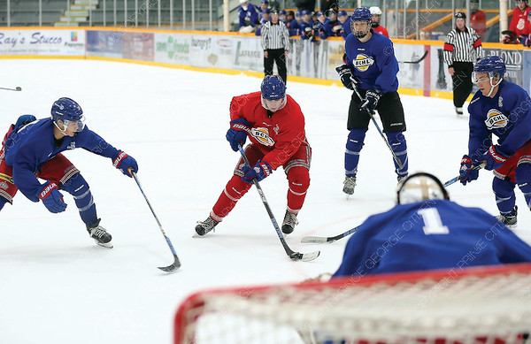 Corey Cunningham of Team Red tries to stickhandle through three Team Blue defenders on Sunday morning at Rolling Mix Concrete Arena during the Prince George Spruce Kings Red vs Blue intrasquad game. Citizen Photo by James Doyle      August 26, 2018