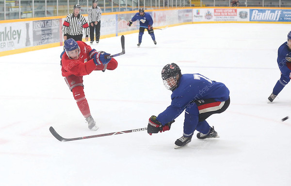 Brennan Malgunas of Team Red blasts a shot on net passed Matthew Marotta of Team Blue on Sunday morning at Rolling Mix Concrete Arena during the Prince George Spruce Kings Red vs Blue intrasquad game. Citizen Photo by James Doyle      August 26, 2018