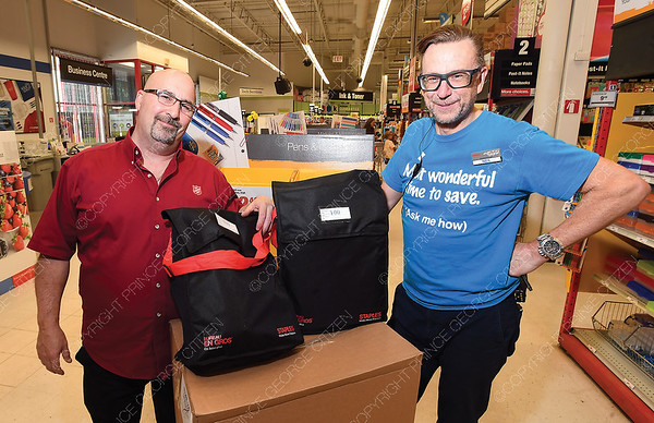 Bill Glasgow with Salvation Army and Neil Hodgson, General Manager of Staples with a couple of bags with school supplies that they are donating to The Salvation Army. Staples Canada annual School Supply Drive is officially underway. Staples in Prince George is raising money for the Salvation Army. Aug 28 2018
