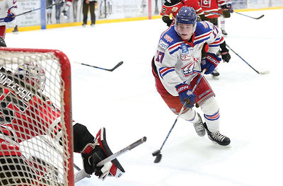 Prince George Spruce Kings forward Nolan Welsh throws a backhand shot on net against sliding Merritt Centennials goaltender Vincent Duplessis on Wednesday night at Rolling Mix Concrete Arena. Citizen Photo by James Doyle      August 29, 2018