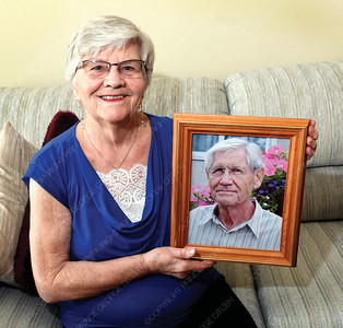 Rosanna Konrad holds the picture of her late husband Dr. Daniel Konrad. For seniors scene column.    Aug 30 2018