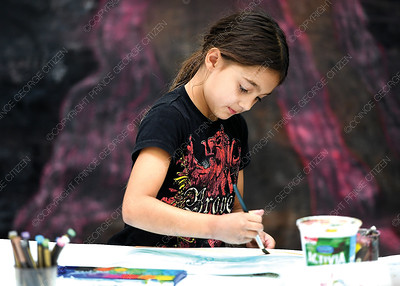 Eesha Dhanjal, 8, uses water colours to paint a picture of a mermaid Thursday morning at Creativity Camp in Two Rivers Gallery.    Aug 30 2018