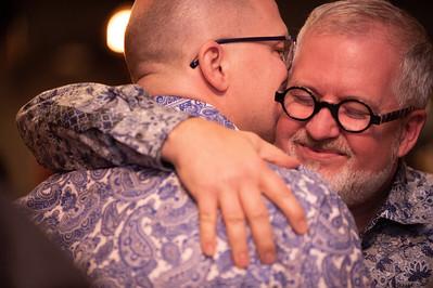 A photo of David and Patrick hugging