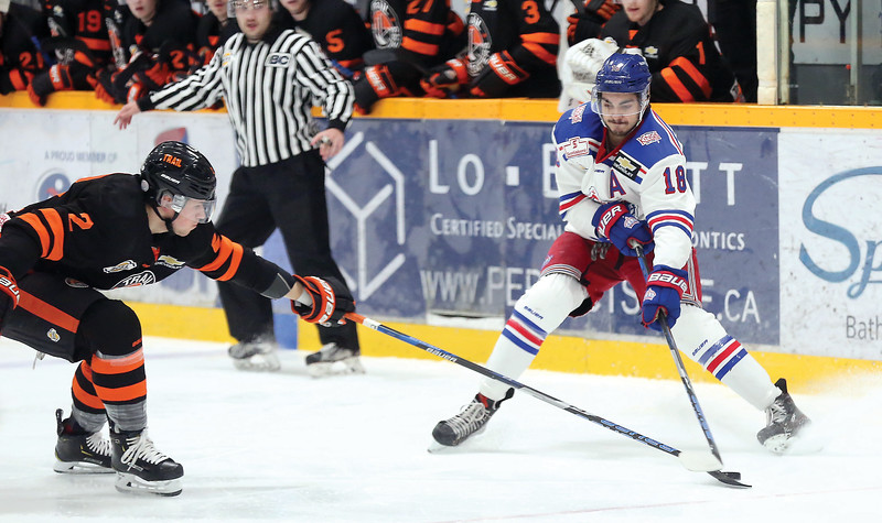 Prince George Spruce Kings forward Ben Brar and Trail Smoke Eaters defender Trevor Zins battle for the loose puck on Wednesday night at Rolling Mix Concrete Arena. Citizen Photo by James Doyle       November 21, 2018