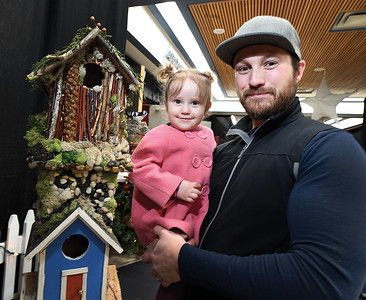 Bridget Lang 18 months and her dad Erik Lang drop off the tiny house, left, that the Lang family built for the Festival of Trees Tiny House auction. Bridget spent the first two weeks of her life in the neonatal intensive care unit of UHNBC and received outstanding care and the family wanted a way to give back to the hospital so as a family: mom; dad; Bridget and her two brothers,  they built a tiny house, this is the second one they have made for the Festival of Trees. Citizen photo Brent Braaten