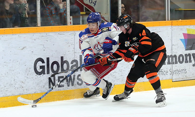 Prince George Spruce Kings forward Chong Min Lee sneaks the puck past the check of Trail Smoke Eaters defender Diarmad DiMurro on Wednesday night at Rolling Mix Concrete Arena. Citizen Photo by James Doyle       November 21, 2018