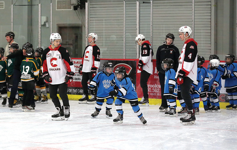 Members of the Prince George Cougars look on as Prince George Minor Hockey players take part in a relay race on Wednesday evening at Kin 1 as part of Prince George Minor Hockey Association's Skate-A-Thon. Citizen Photo by James Doyle      November 21, 2018