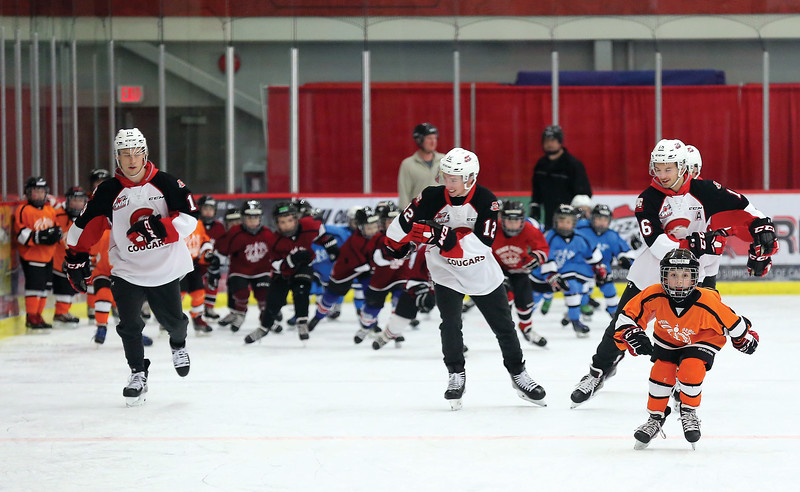 Members of the Prince George Cougars skate with Prince George Minor Hockey players on Wednesday evening at Kin 1 as part of Prince George Minor Hockey Association's Skate-A-Thon. Citizen Photo by James Doyle      November 21, 2018