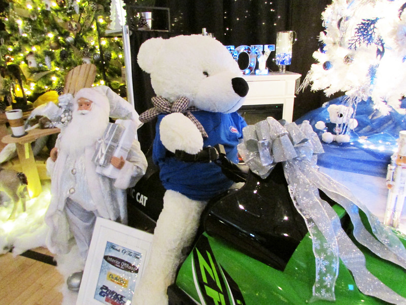 A teddy bear riding a snowmobile is on display at the 25th annual Festival of Trees at the Civic Centre until Dec. 2. Citizen photo by Christine Hinzmann