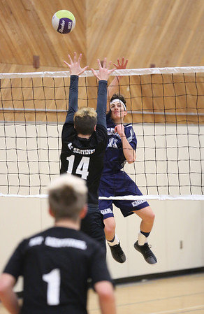 Cedars Christian Eagles Craig Hein tips the ball over the reach of Mt. Sentinel Wildcats blocker Logan Smart on Saturday afternoon at College of New Caledonia gymnasium as part of the 2018 Senior A Boys Volleyball Provincial Championships. Citizen Photo by James Doyle        November 24, 2018