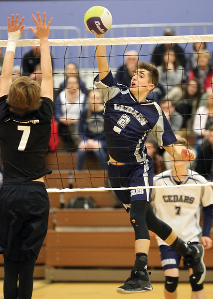 Cedars Christian Eagles Joel Nelson attempts to spike the ball against Mt. Sentinel Wildcats blocker Ryan Pearce on Saturday afternoon at College of New Caledonia gymnasium as part of the 2018 Senior A Boys Volleyball Provincial Championships. Citizen Photo by James Doyle        November 24, 2018