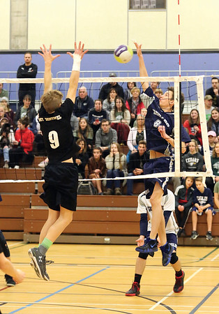 Cedars Christian Eagles Lucas Crosina attempts to spike the ball against Mt. Sentinel Wildcats blocker Xavier Moore on Saturday afternoon at College of New Caledonia gymnasium as part of the 2018 Senior A Boys Volleyball Provincial Championships. Citizen Photo by James Doyle        November 24, 2018