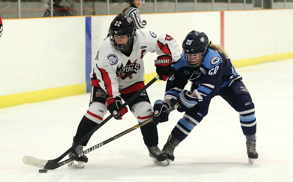 Northern Capitals forward Camryn Scully looks to make a play while proecting the puck from the check of Thompson Okanagan Lakers defender Sydney Hamilton on Satruday afternoon at Kin 1 in the second of three weekend games between the two teams. Citizen Photo by James Doyle        November 24, 2018