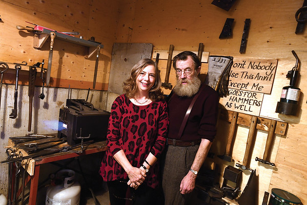 Liz and Dr. George Haley for the seniors scene column. The couple was photographed in George's blacksmith shop. Citizen photo by Brent Braaten